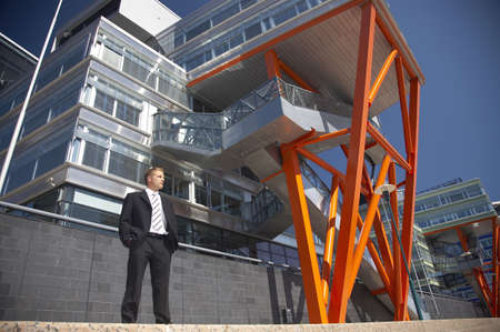 Businessman posing outdoors in front of a building Stock Photo - 3194063