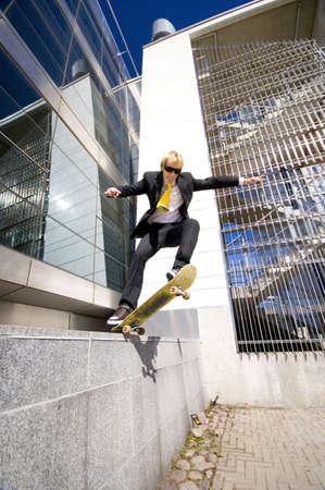 Businessman skateboarding Stock Photo - 3194064