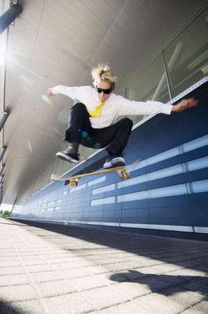 extreme sport: Businessman skateboarding