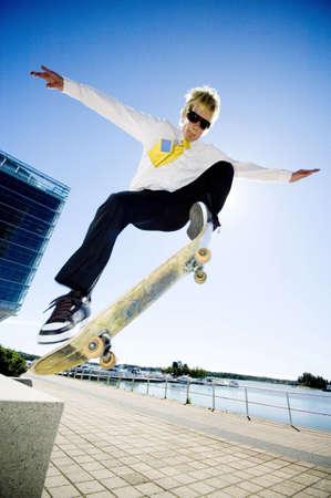 Businessman skateboarding Stock Photo - 3194067
