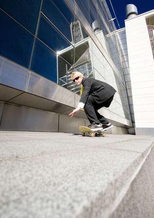 Businessman skateboarding Stock Photo - 3194068