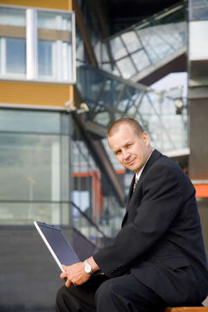 Businessman posing with laptop outdoors Stock Photo - 3194070