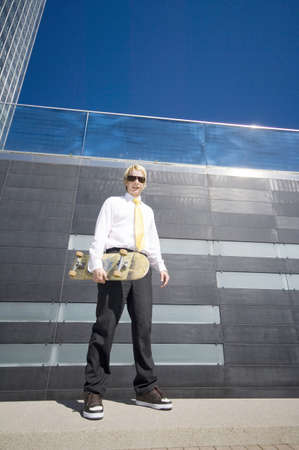 Businessman posing with skateboard Stock Photo - 3194071