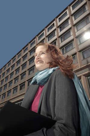 Businesswoman smiling while holding organizer Stock Photo - 3194072