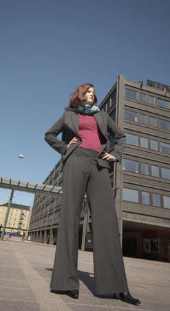 arms akimbo: Businesswoman standing with arms akimbo LANG_EVOIMAGES