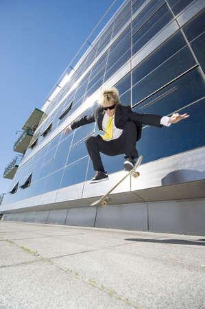 Businessman skateboarding Stock Photo - 3194077