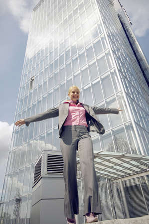 Businesswoman balancing herself while walking in a straight line Stock Photo - 3194078