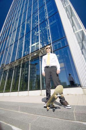 Businessman skateboarding