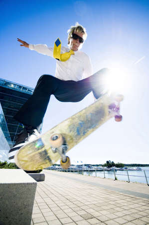 Businessman skateboarding Stock Photo - 3194081