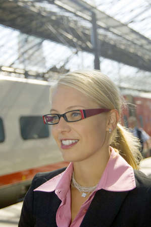 Businesswoman with glasses smiling while looking away