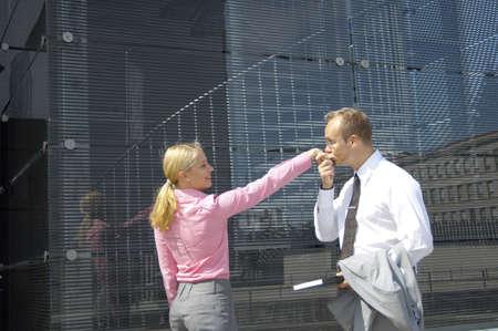 Businessman kissing businesswoman's hand Stock Photo - 3194086