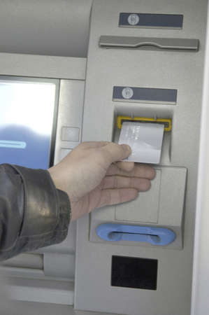 Hand inserting card into ATM  Stock Photo - 3194087