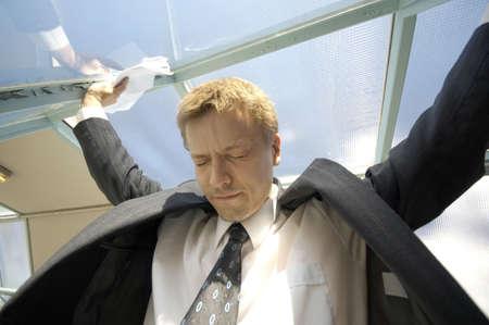 eyes closing: Businessman closing his eyes while looking down
