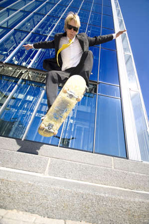 Businessman skateboarding Stock Photo - 3194092