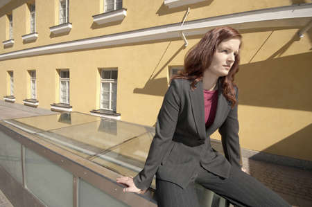 Businesswoman sitting down daydreaming