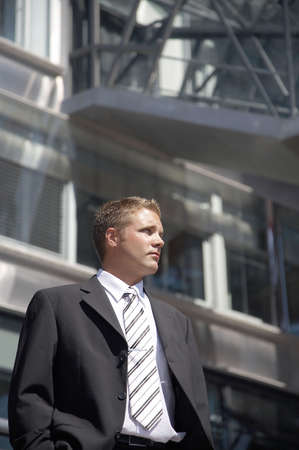 Businessman posing outdoors in front of a building Stock Photo - 3194108