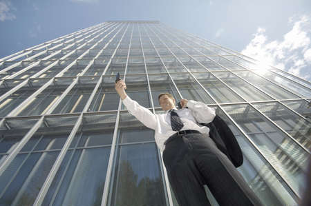 Businessman taking his self picture with camera phone
