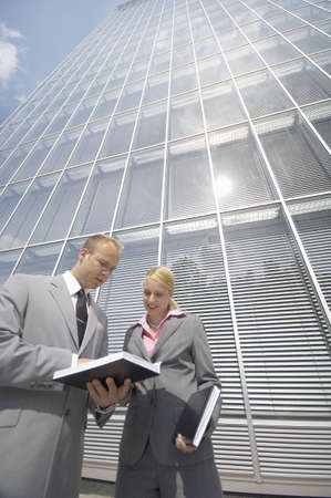 Businessman and businesswoman having discussion Stock Photo - 3194112