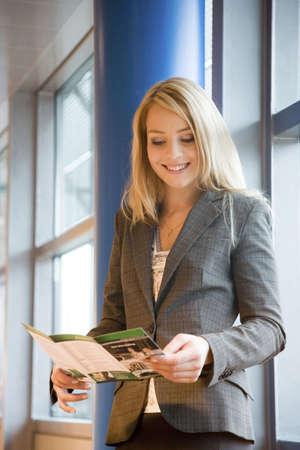 Businesswoman reading a brochure