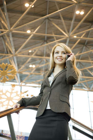 Businesswoman talking on the mobile at the airport terminal Stock Photo - 3194125