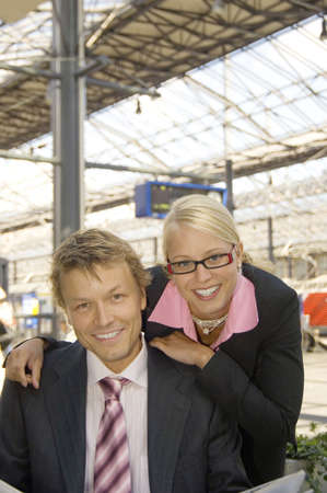 Businessman and businesswoman smiling at the camera Stock Photo - 3194131