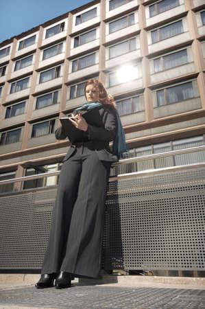 Businesswoman writing on organizer