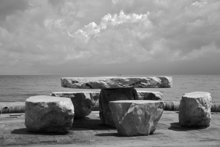 stone table set on the beach