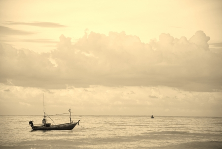 Lonely boat on the see at Prachuap bay