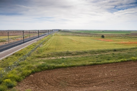 agrarian: View of a High-speed rail stretch trough agrarian landscape in Toledo (Spain)