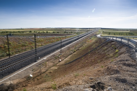 View of a High-speed rail stretch trough agrarian landscape in Toledo (Spain)