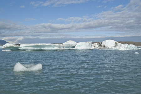 Icebergs in Jokulsarlon Lake (Iceland). Jokulsarlon is the largest glacier lagoon or lake in Iceland photo