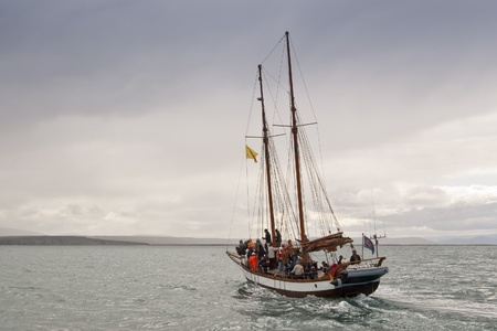 whale watching: Sailing ship for whale watching. Picture taking in Skjalfandi Bay (Iceland) Editorial