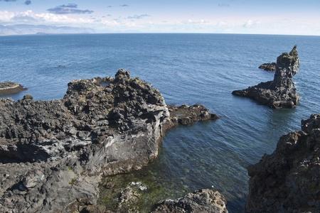 Volcanic coastal cliffs in Arnarstapi (Iceland)