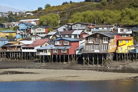 Palafitos in Castro. Castro is the capital of Chiloé Province, in the Los Lagos Region, Chile. Palafitos are houses raised on piles over the surface of the soil or a body of water  Editorial