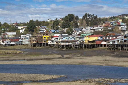 Palafitos in Castro. Castro is the capital of Chiloé Province, in the Los Lagos Region, Chile. Palafitos are houses raised on piles over the surface of the soil or a body of water  Stock Photo