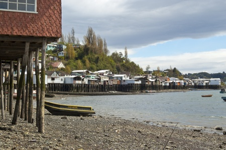 Palafitos in Castro. Castro is the capital of Chilo� Province, in the Los Lagos Region, Chile. Palafitos are houses raised on piles over the surface of the soil or a body of water  Stock Photo - 11970855
