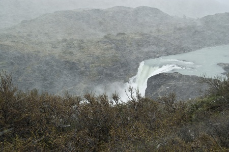 Waterfall under storm in Torres del Paine National Park, Chile photo