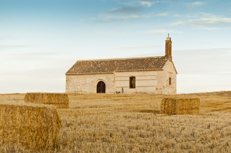Small chapel in a rural landscape in Ciudad Real Province, Spain photo
