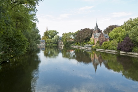 The Minnewater, Brugges. Minnewater lake is a canalized lake in Bruges, Belgium. The Dutch word Minne meaning love Stock Photo - 12470445