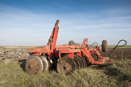 Disk Ripper in the field  Plough is a tool used in farming for initial cultivation of soil photo