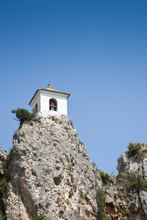 Belfry on the peak of the mountain in El Castell de Guadalest, Alicante, Spain   photo