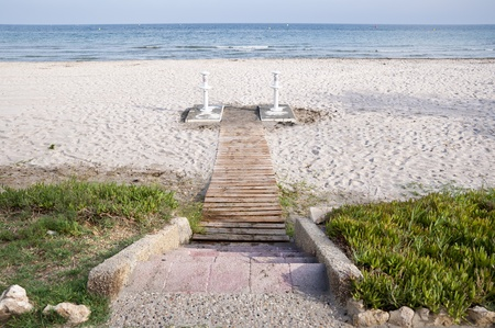 Wooden access footpath to the beach  Picture taken in Santa Pola town  It is a coastal town located in the comarca of Baix Vinalopo, in the Valencian Community, Alicante, Spain, by the Mediterranean Sea