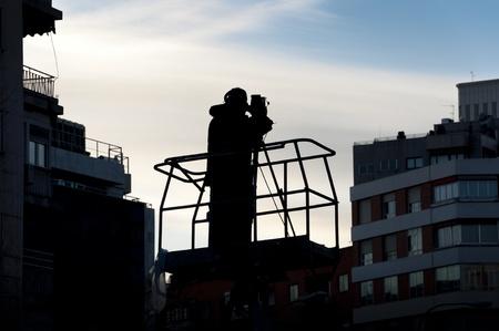 Cameraman working on an aerial work platform photo