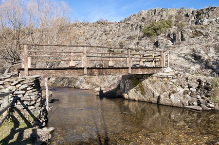 Rustic footbridge over Jarama River, La Hiruela, Madrid, Spain Stock Photo - 13569338