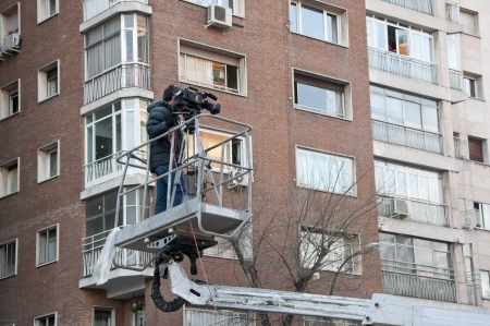 cinematographer: Cameraman working on an aerial work platform Editorial