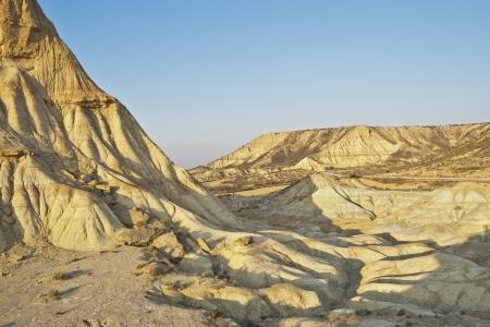 tabular: Semi-desert landscape in Bardenas Reales, Navarre, Spain  The Bardenas Reales is a semi-desert natural region, or badlands, in southeast Navarre, Spain