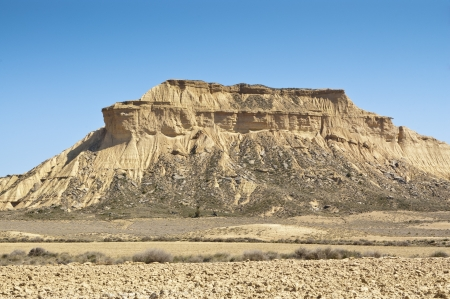 Semi-desert landscape in Bardenas Reales, Navarre, Spain  The Bardenas Reales is a semi-desert natural region, or badlands, in southeast Navarre, Spain