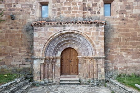 millan: Door of San Millan de Lara Church, Burgos Province, Spain  It was building on 1165 in Romanesque style
