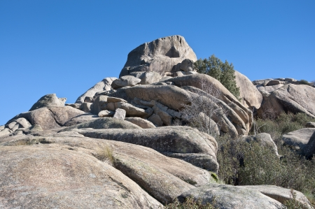 Views of La Pedriza, Madrid, Spain  It is a granite mountain where geological forces have create a remarkable boulder field of strangely eroded granite outcrops   Фото со стока