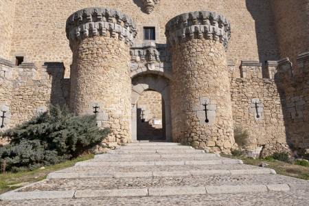 restoring: Entrance door of the New Castle of Manzanares el Real, Madrid Province, Spain  Also known as Castle of los Mendoza, is a palace-fortress erected in the 15th century